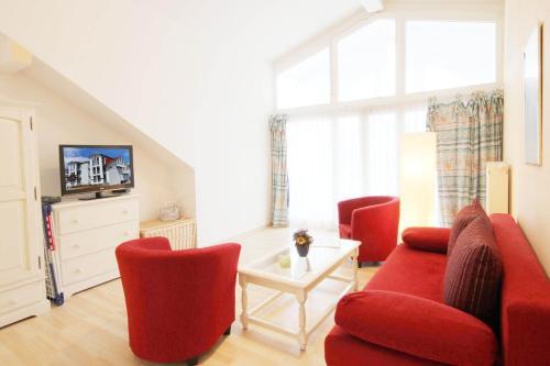 Ein Sitzbereich in der Unterkunft Haus & Villa Strandidyll by Rujana