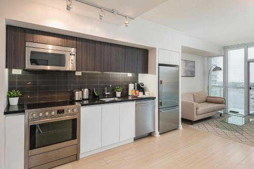A kitchen or kitchenette at Diamond Vacation Homes - City Place