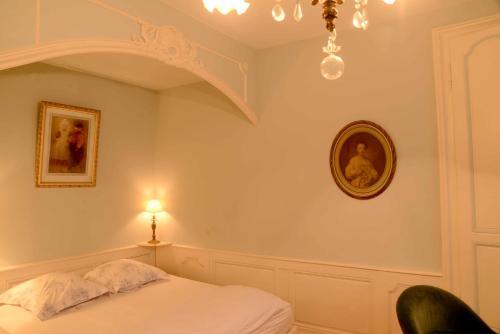 Un ou plusieurs lits dans un hébergement de l'établissement Gîte Le Stanislas