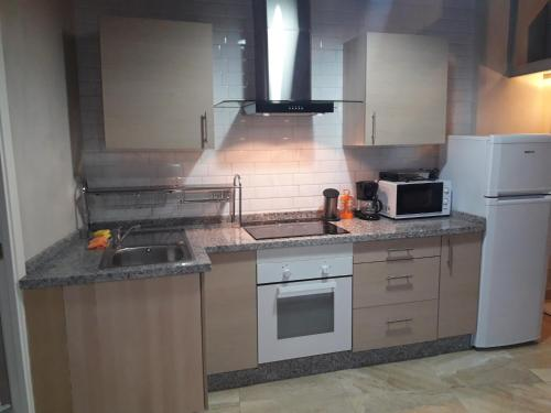 A kitchen or kitchenette at Loft-Duplex Centro City