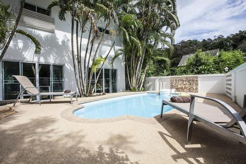 The swimming pool at or near VILLA JUNGLE 2 BEDROOMS