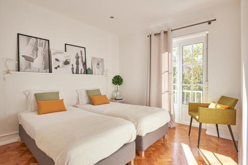 A bed or beds in a room at Your Lisbon Apartment