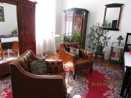 A seating area at Art Nouveau Apartment
