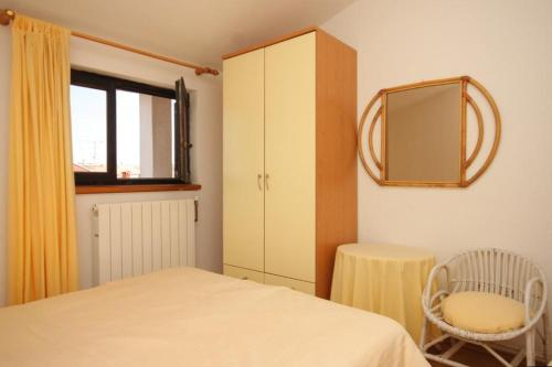A bed or beds in a room at Apartment Rovinj 7656b