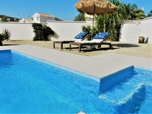 The swimming pool at or near The Olive Tree Villa