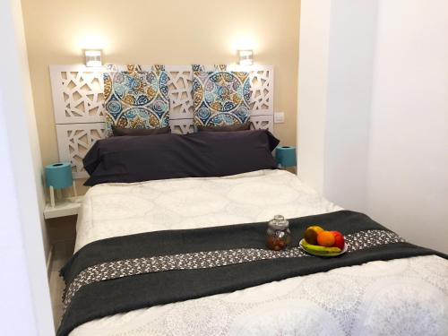 A bed or beds in a room at Sunny Islands TQ