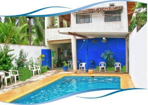 The swimming pool at or near Bungalows La Playa