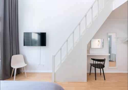 TV a/nebo společenská místnost v ubytování Here House Hongdae