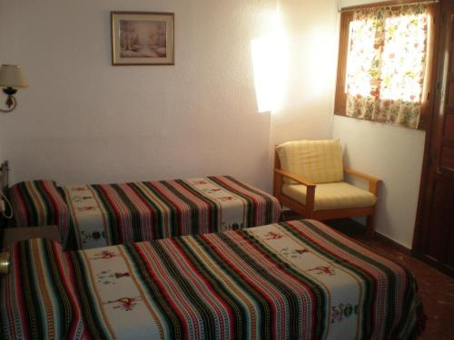 A bed or beds in a room at Castillo del Mar