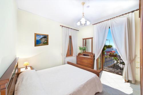 Letto o letti in una camera di Villa Costanzo