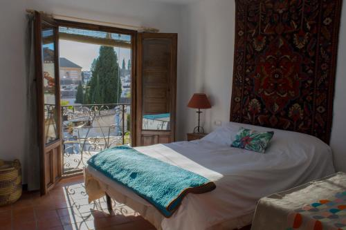 A bed or beds in a room at Casa Franci