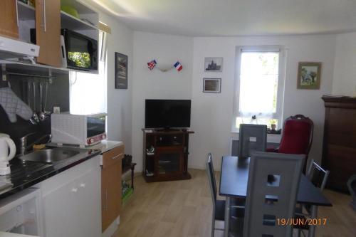 A kitchen or kitchenette at Gite Gerard