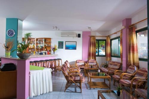 A restaurant or other place to eat at Golden Sun Hotel
