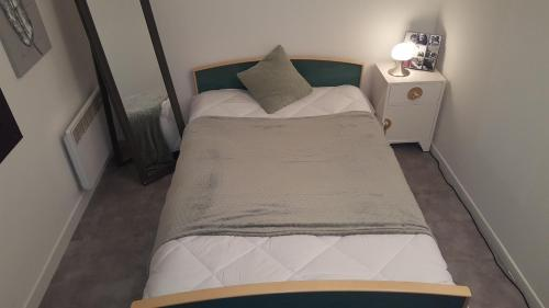 A bed or beds in a room at BeRelax