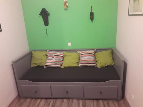 A seating area at Small but Sweet apartment