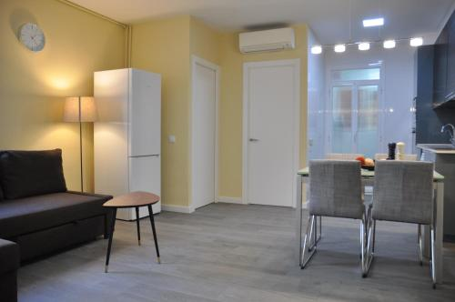 A seating area at Apartamento Sants