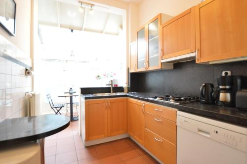 A kitchen or kitchenette at Spacious garden apartment Jordaan