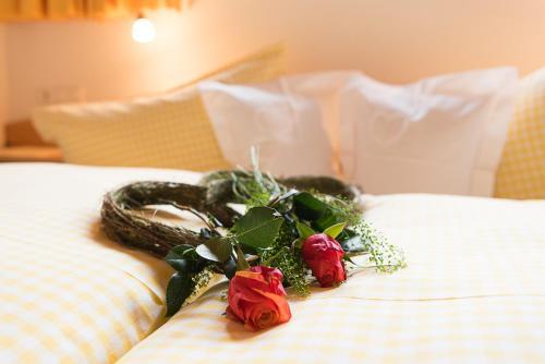 Ein Bett oder Betten in einem Zimmer der Unterkunft Gästehaus Graf