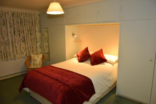 A bed or beds in a room at Teign Head Garden Flat