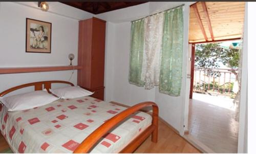 A bed or beds in a room at Apartments Kassa