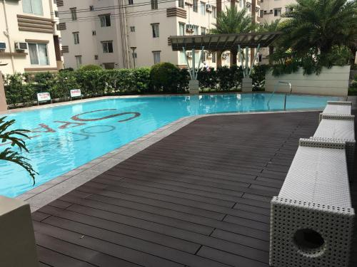 The swimming pool at or near Cozy Condo Unit within Metro Manila