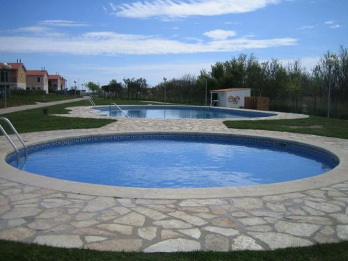 The swimming pool at or near Casa Mas Pinell 93