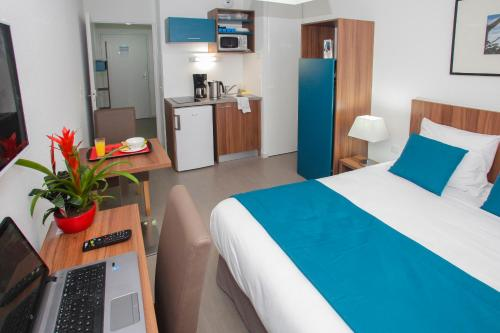 A bed or beds in a room at Odalys City Orléans Saint Jean