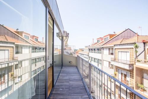 A balcony or terrace at Bonjardim Apartment Porto Center