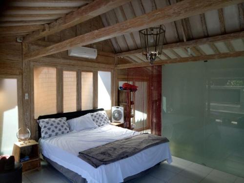 Postel nebo postele na pokoji v ubytování Surf Shack