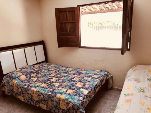 Cama o camas de una habitación en Casa Em Praia Azul