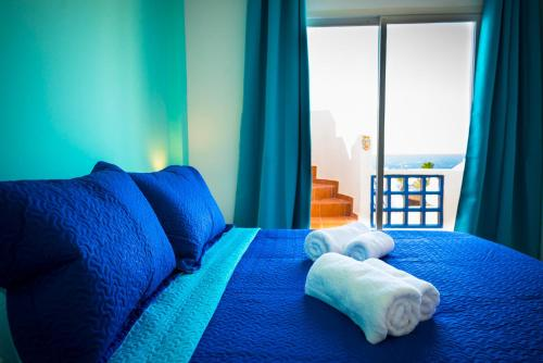 A bed or beds in a room at Dream View