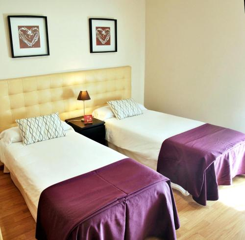 A bed or beds in a room at Aparthotel Encasa