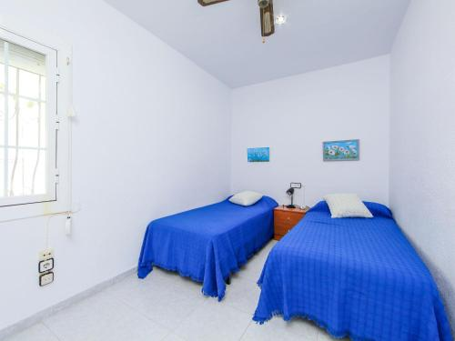 A bed or beds in a room at Holiday Home Bungalow Los Corales