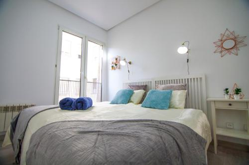 A bed or beds in a room at Apartamento Céntrico - Montera