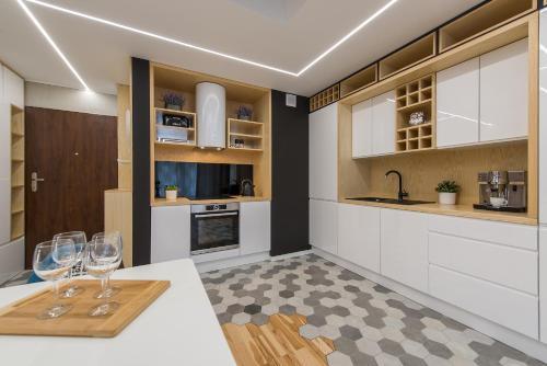 Virtuvė arba virtuvėlė apgyvendinimo įstaigoje P&O Apartments Cybernetyki