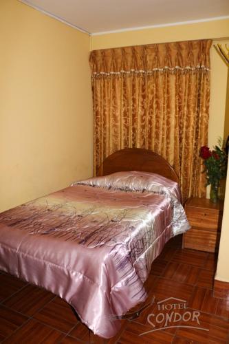 Cama o camas de una habitación en Hostal Alameda