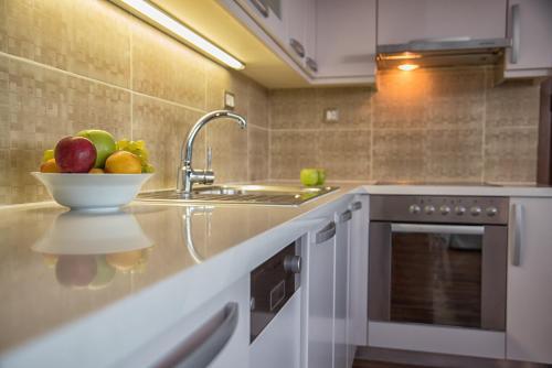 A kitchen or kitchenette at Elounda Maris Villas
