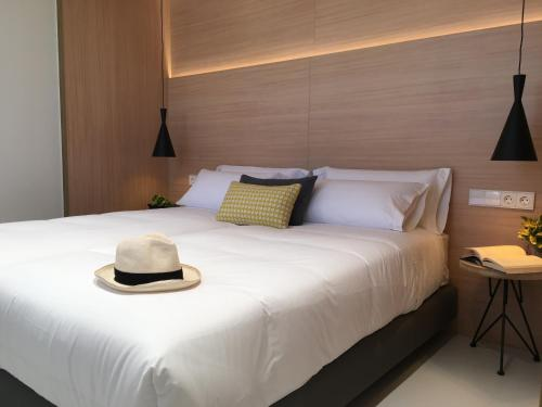 Cama o camas de una habitación en Inside Bilbao Apartments