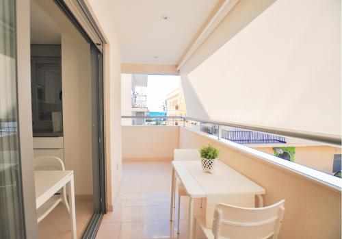 A balcony or terrace at Sitito Good Life Apartment