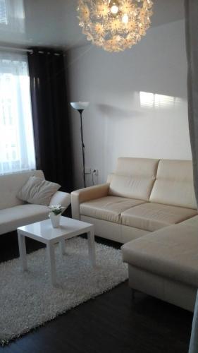 A seating area at Centrum Apartments - I. P. Pavlova