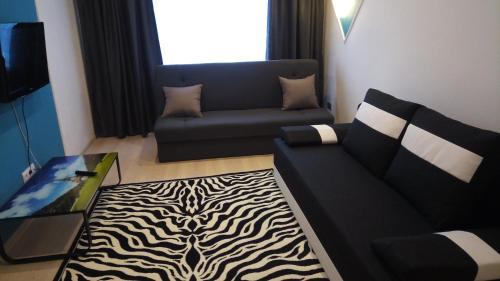 Гостиная зона в Pillau Apartments
