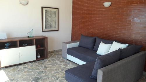 A seating area at App.ti Scala Dei Turchi Tetide