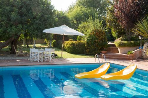 The swimming pool at or near La Casetta Sicilian Cottage