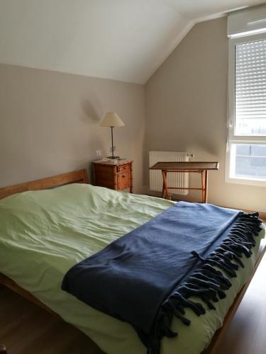 Un ou plusieurs lits dans un hébergement de l'établissement Maison particulière