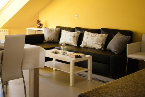 Zona de estar de Apartamentos Casa de Baixo
