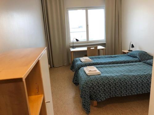 Ein Bett oder Betten in einem Zimmer der Unterkunft Töölö Towers