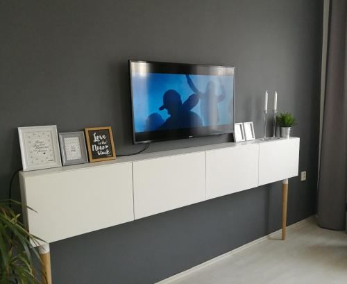 A television and/or entertainment center at Apartment Kosicka