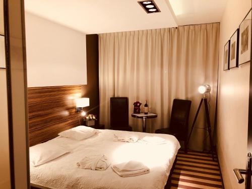 A bed or beds in a room at Apartament 231 Diva
