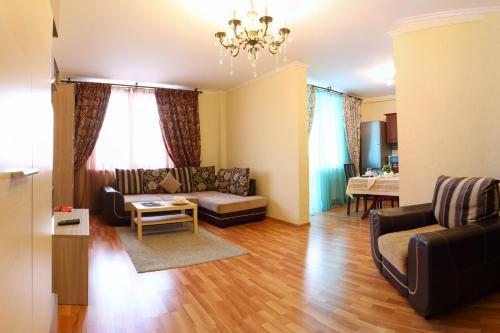 Гостиная зона в Апартаменты «Мечта 24»