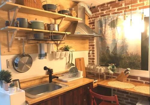 A kitchen or kitchenette at Hongdae Min House
